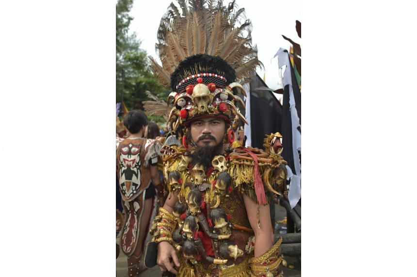 A Dayak tribe member on Borneo island. Dayaks have a long-held tradition that dictates that they cannot leave a place that has been set on fire until the fire stops.