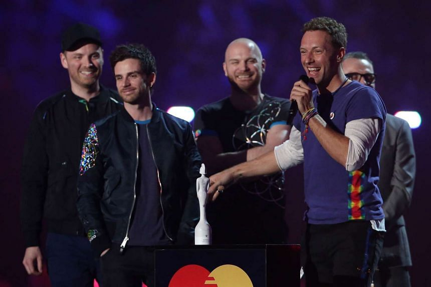British musician Chris Martin (right) and members of the band Coldplay on Feb 24, 2016.