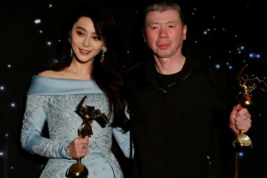 Chinese actress Fan Bingbing and director Feng Xiaogang with their Best Actress and Best Film awards at the Asian Film Awards in Hong Kong, China.