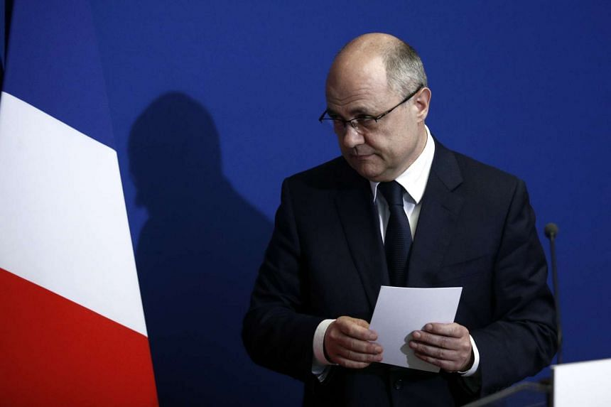 French Interior Minister Bruno Le Roux reacts after delivering a speech to announce his resignation at the Prefecture of Bobigny, near Paris, France, on March 21, 2017.