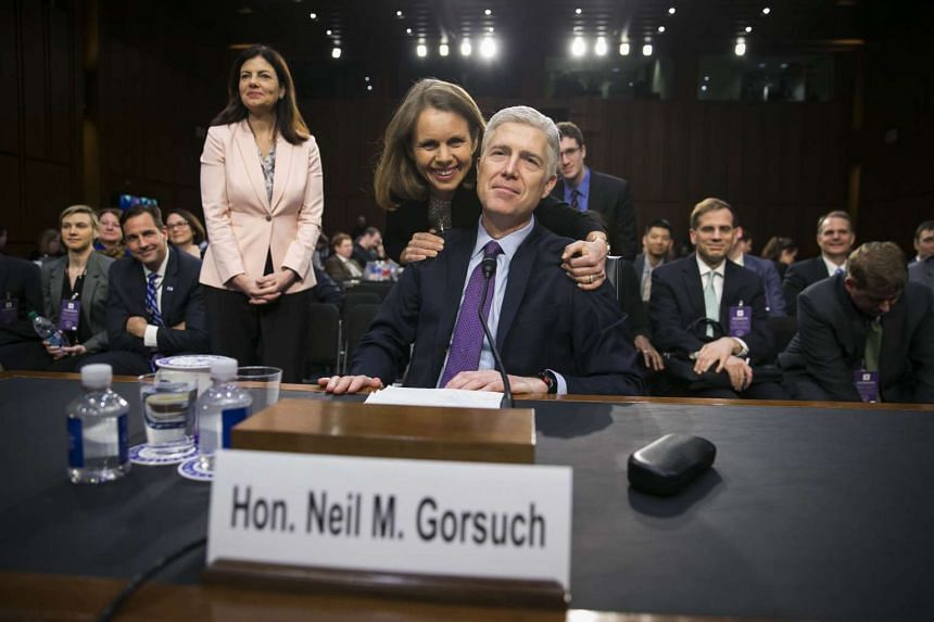 Judge Neil Gorsuch is hugged by his wife at the end of the second day of his confirmation hearing before the Senate Judiciary Committee.