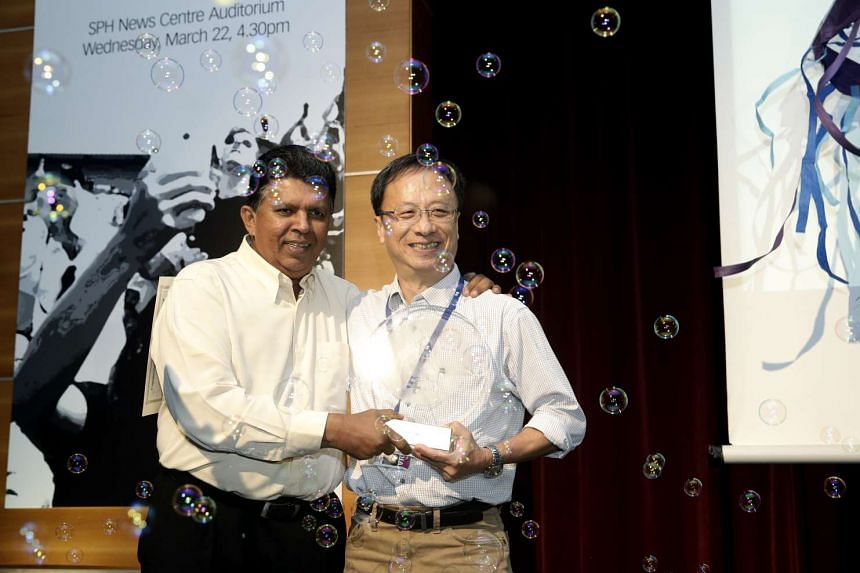 SPH Deputy CEO Patrick Daniel (left) presenting Journalist of the Year Christopher Tan with his award at the SPH English Malay Tamil Newspaper (EMTM) Division Annual Awards ceremony.