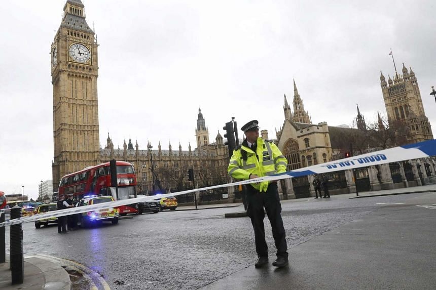 Police tapes off Parliament Square after reports of loud bangs, in London, Britain, on March 22, 2017.
