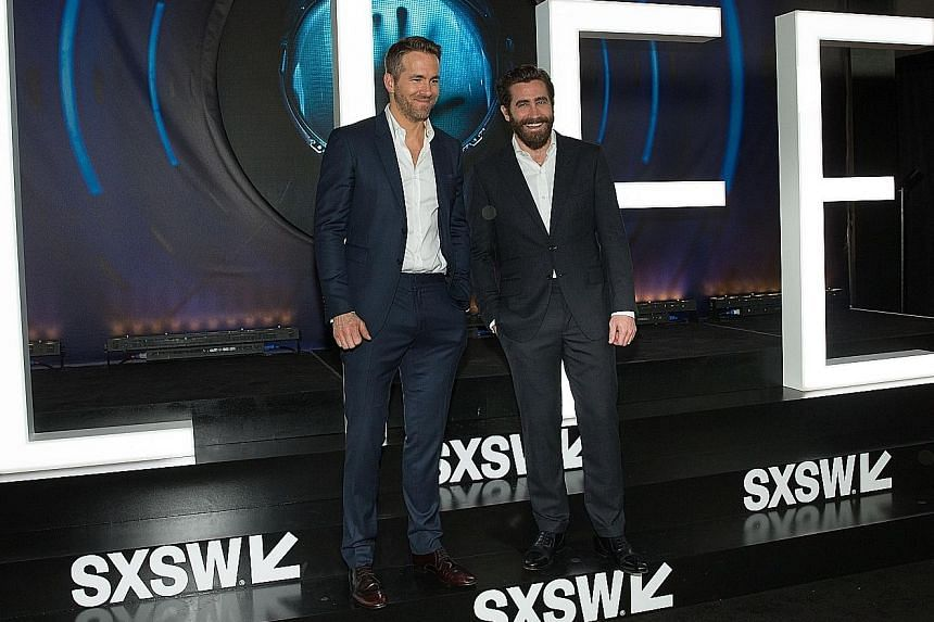 A-listers Ryan Reynolds (far left) and Jake Gyllenhaal lead the cast of sci-fi blockbuster Life.