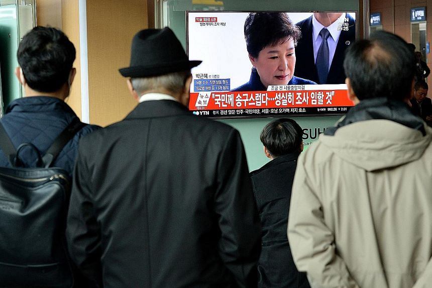 South Koreans watching TV coverage of the investigation into Ms Park Geun Hye's alleged involvement in a corruption and influence-peddling scandal that led to her downfall.