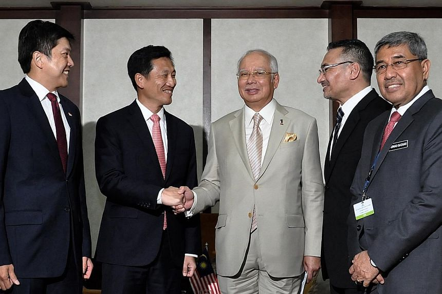 From left: Second Minister for Transport Ng Chee Meng and Second Minister for Defence Ong Ye Kung calling on Malaysian Prime Minister Najib Razak, who is accompanied by Minister of Defence Hishammuddin Hussein and Menteri Besar of Kedah Ahmad Bashah