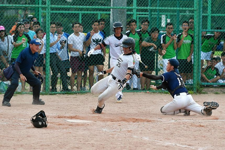 Left: CHS catcher Joshua Tan (No. 13), tagging RI's Zachar Oh (No. 25) during the bottom of the fourth inning. Below: CHS boys celebrating with a lap of honour after beating eight-time defending champions RI to win their first Schools National B Divi