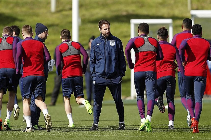 England manager Gareth Southgate (facing camera) during a training session yesterday. Striker Jermain Defoe, 34, is in line to return after more than three years for today's friendly against World Cup champions Germany.