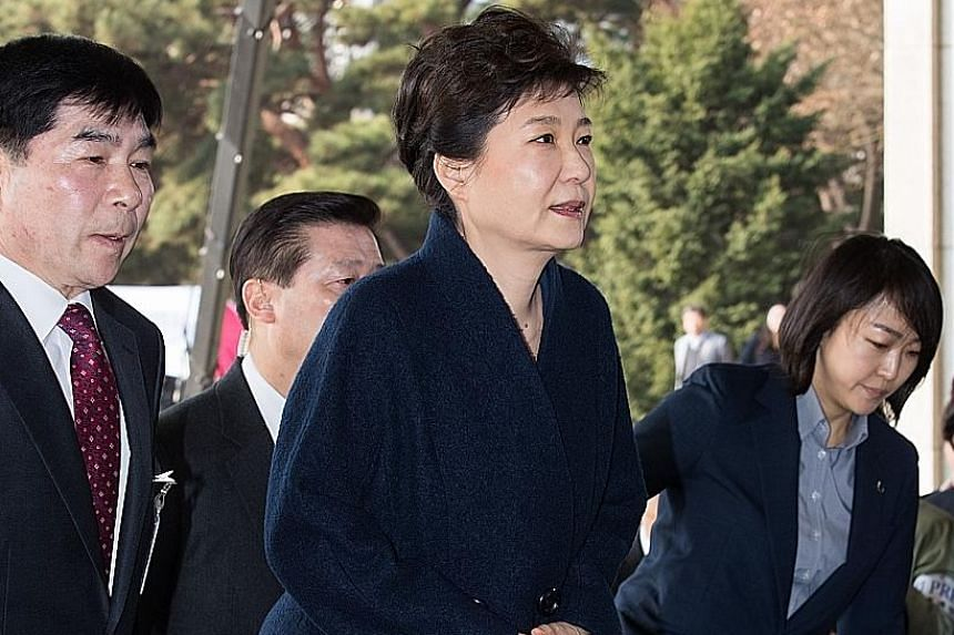 Former South Korean president Park Geun Hye apologised to the country yesterday as she arrived at the prosecutors' office for questioning as a criminal suspect in a corruption scandal. She became South Korea's first democratically elected president t