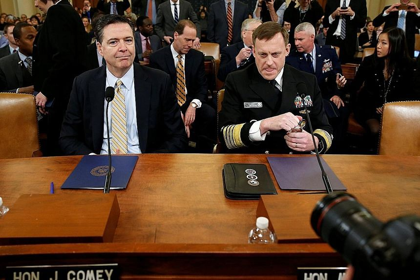 Mr James Comey (left), with National Security Agency director Mike Rogers at a House Intelligence Committee hearing on Monday, confirmed that the FBI is investigating Russia's interference in the US presidential election last year. He said there was