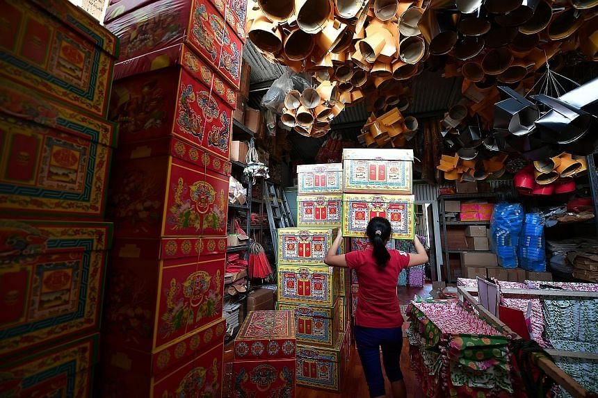 """""""Treasure chests"""" on sale at the Yeo Swee Huat Paper Agency in Toa Payoh. Such items are burnt as offerings to the dead during the Qing Ming period, but the resulting ash has left some people fuming."""