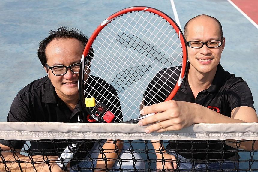 9 Degrees Freedom's co-founders, Mr Lee (left) and Dr Soh, with their device, Qlipp, which detects and records a tennis player's performance. The company posted $300,000 in revenue last year - double its sales in 2015.