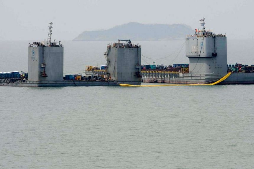 Barges seen during a salvage operation of sunken ferry Sewol at the sea off Jindo, South Korea, on March 22, 2017.