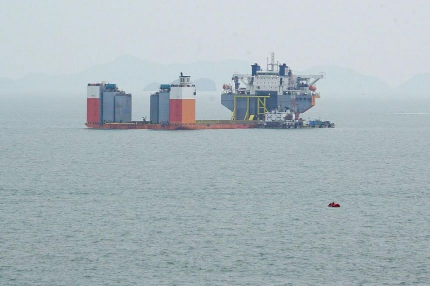 This handout photo provided and taken on March 22, 2017, by the South Korean Maritime Ministry shows a submersible vessel to take the sunken Sewol ferry to the nearest port once it is lifted out of water, during a salvage project off the south-wester