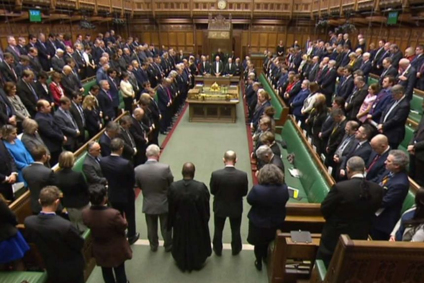 A still image taken from footage broadcast by the UK Parliamentary Recording Unit (PRU) on March 23, 2017 shows Members of Parliament standing for a minutes silence in a gesture of defiance a day after the London terror attack.