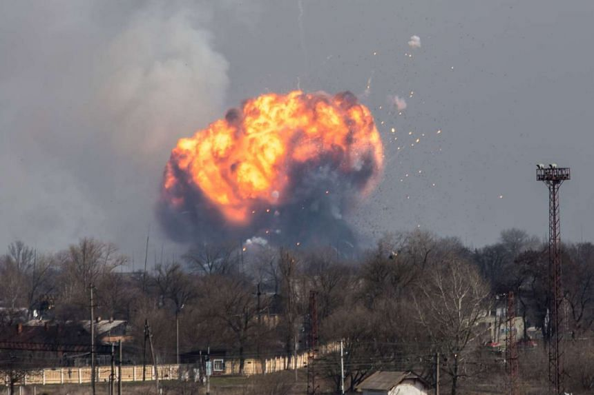A huge cloud of smoke with fire billows from the site of an ammunition depot of the Ukrainian Armed Forces, near the city of Balakiya, Kharkiv area, on March 23, 2017.