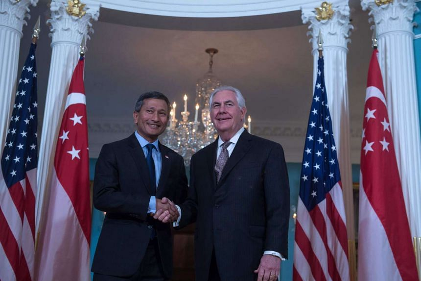 US Secretary of State Rex Tillerson and Singapore's Foreign Minister Vivian Balakrishnan shake hands at the State Department in Washington, DC, on March 22.