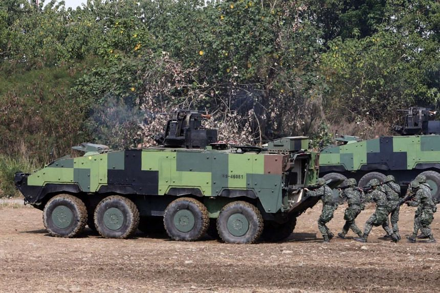 Taiwan plans show to reel in more to join its army, East