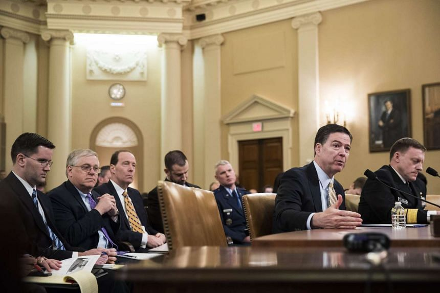 From left: James Comey, director of the Federal Bureau of Investigation (FBI), and Michael Rogers, director of the National Security Agency, testify during a House Permanent Select Committee on Intelligence hearing concerning Russian meddling in the