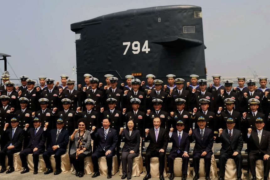 Taiwan President Tsai Ing-wen (centre, front row) poses for photos with navy servicemen in front of a Duch-made Sea Tiger submarine at the Tsoying navy base in Kaohsiung, southern Taiwan.