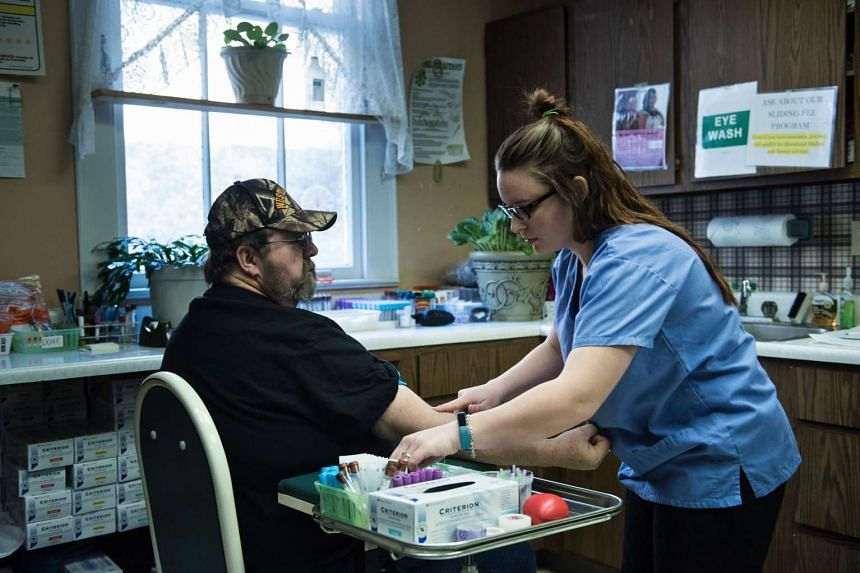 A patient has his blood drawn at the Community Health Centre in Burton, West Virginia.