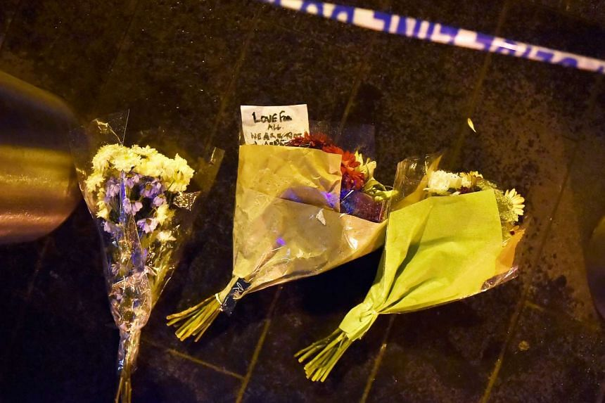 Flowers are laid at the scene after the attack on Westminster Bridge in London, Britain, March 22, 2017.
