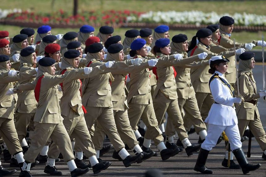 Female Pakistani soldiers march past during a Pakistan Day military parade in Islamabad on March 23.