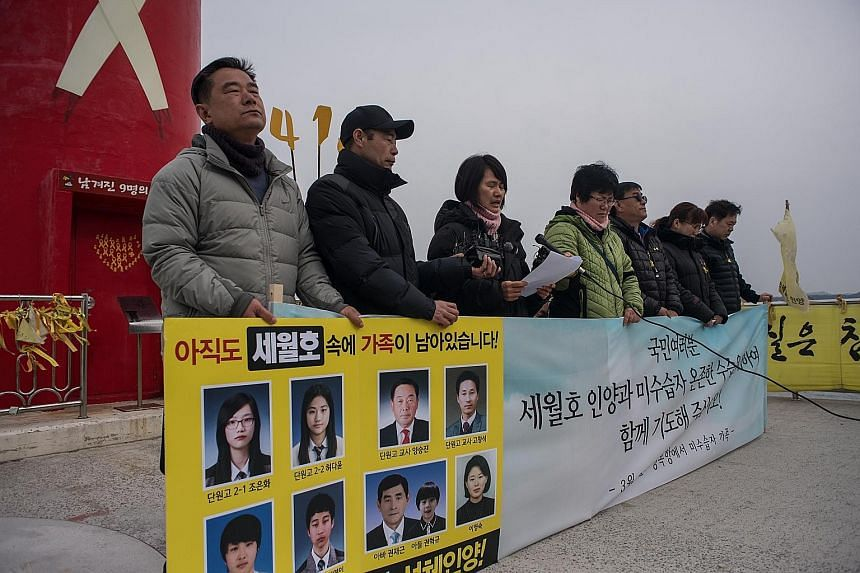 Relatives of missing victims of the Sewol ferry disaster speaking to the media on a pier at Paengmok harbour on the southern island of Jindo yesterday.