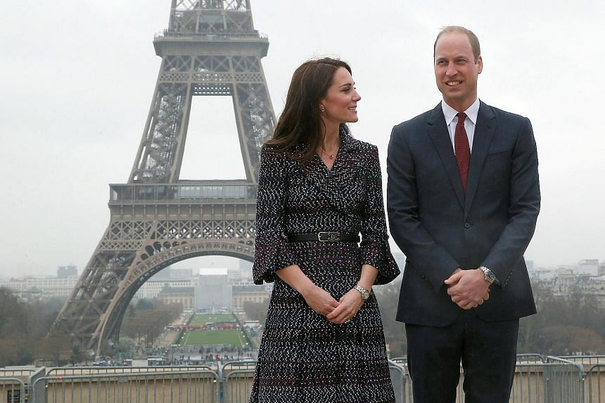 Britain's Prince William and the Duchess of Cambridge, who wore a dress and belt by French fashion house Chanel as well as Cartier accessories on their first official visit to Paris.