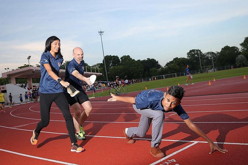 NorthLight School student Muhd Syahmil Samsudin (right) is one of the beneficiaries of the In My Shoes movement. Founded by national hurdler Dipna Lim-Prasad and James Walton, head of Deloitte South-east Asia's sports business service line, the movem
