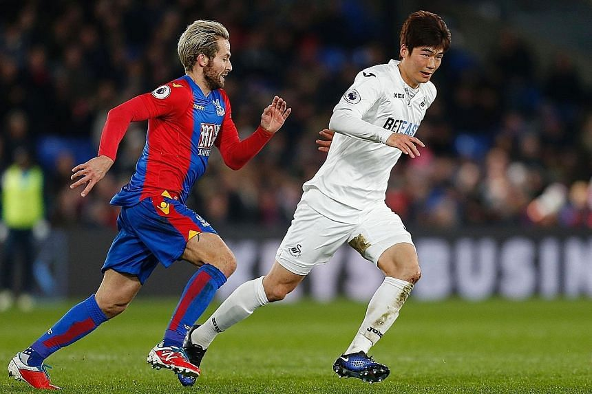 South Korea will be able to call on Swansea City midfielder Ki Sung Yueng, seen here keeping the ball away from Crystal Palace midfielder Yohan Cabaye in an English Premier League match.