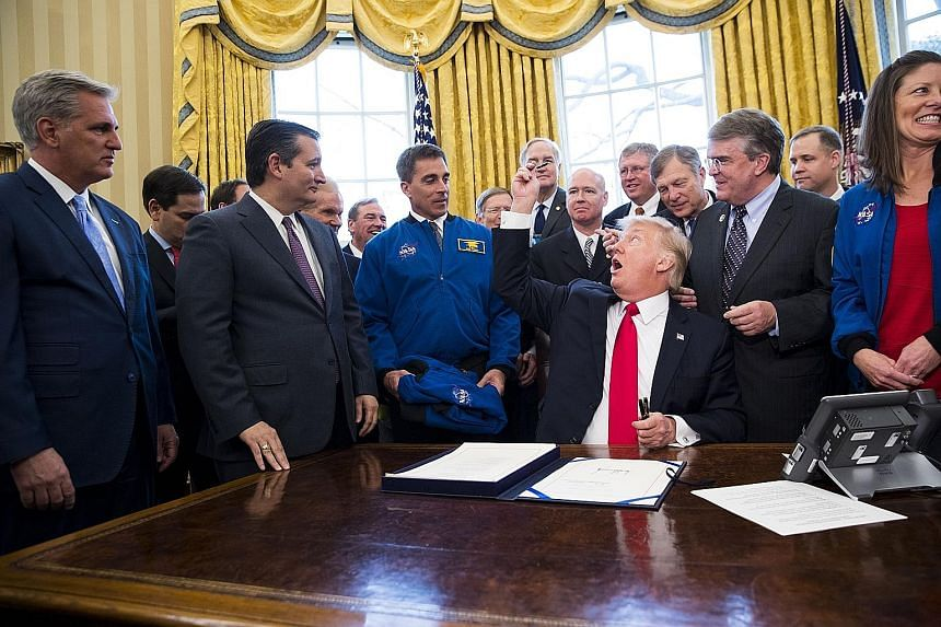 Mr Trump at the signing of an appropriations Bill for the Nasa space agency in the Oval Office of the White House on Tuesday. He is trying to get all the backing he can for a sweeping Bill to overhaul the US healthcare system. The President can lose