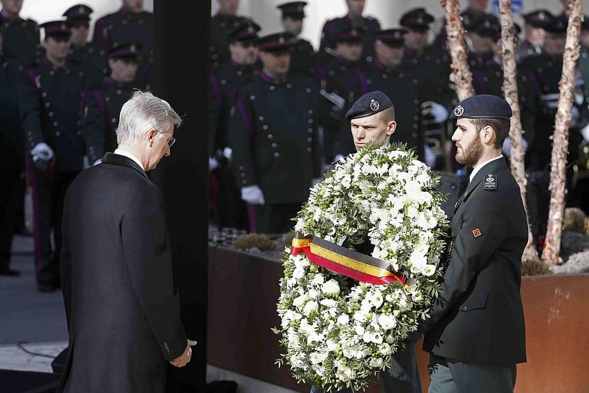 Belgium's King Philippe laying a wreath to commemorate the victims of the attacks at Zaventem airport and Maalbeek metro station last year.