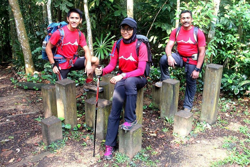 Mr Jeremy Tong, Ms Yusrina Ya'akob and Dr Arjunan Saravana Pillai at one of their training sessions at Bukit Timah Nature Reserve on Sunday. The three, who are gunning to be the first Singaporean team since 2009 to reach the top of the world's talles