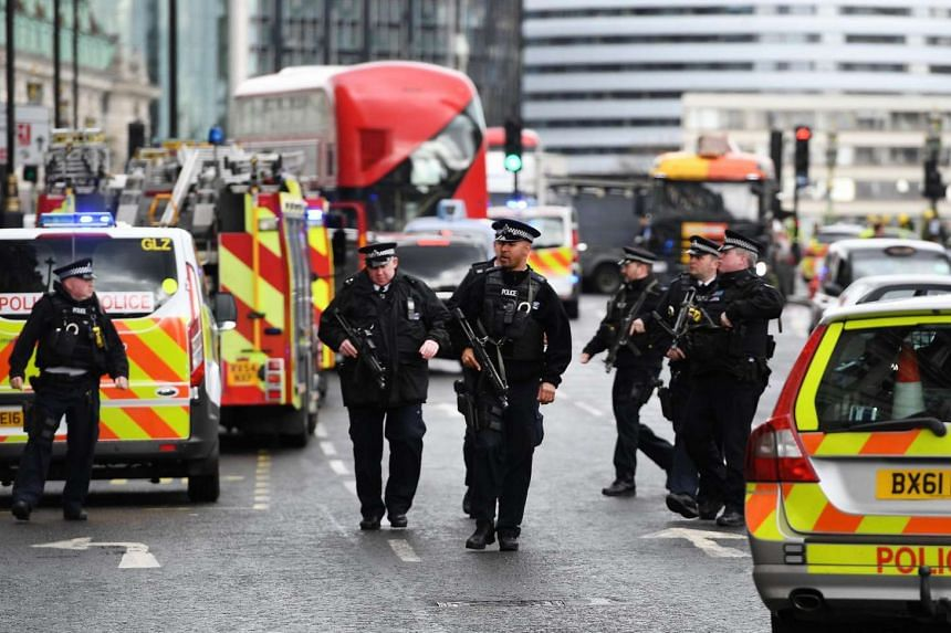 Armed police arrive following major incidents outside the Houses of Parliament in central London, Britain on March 22, 2017.