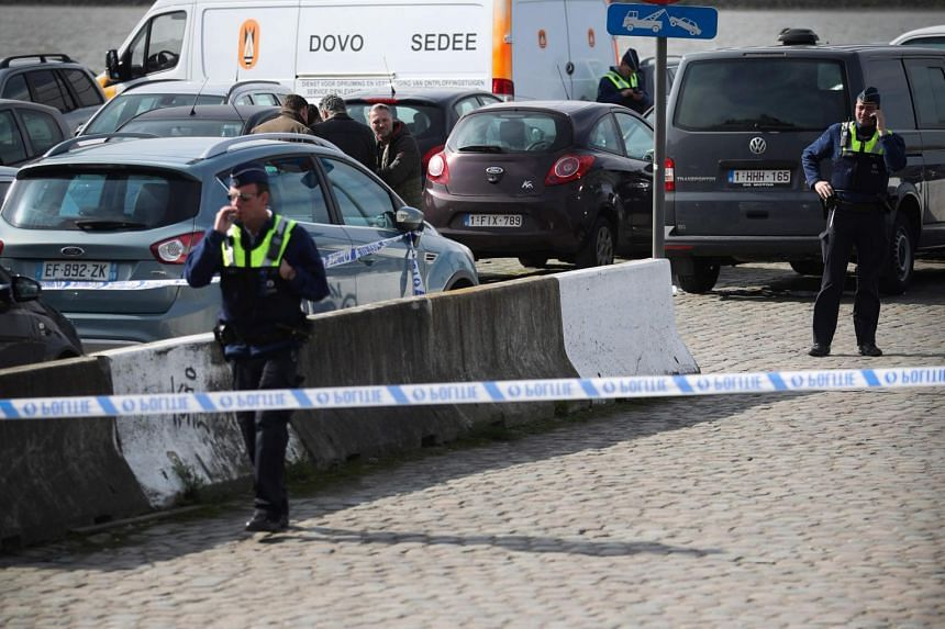 Police officers and and the mine clearance service of Belgian defence patrol in Antwerp after a man tried to drive into a crowd at high-speed in a shopping area in the port city of Antwerp.