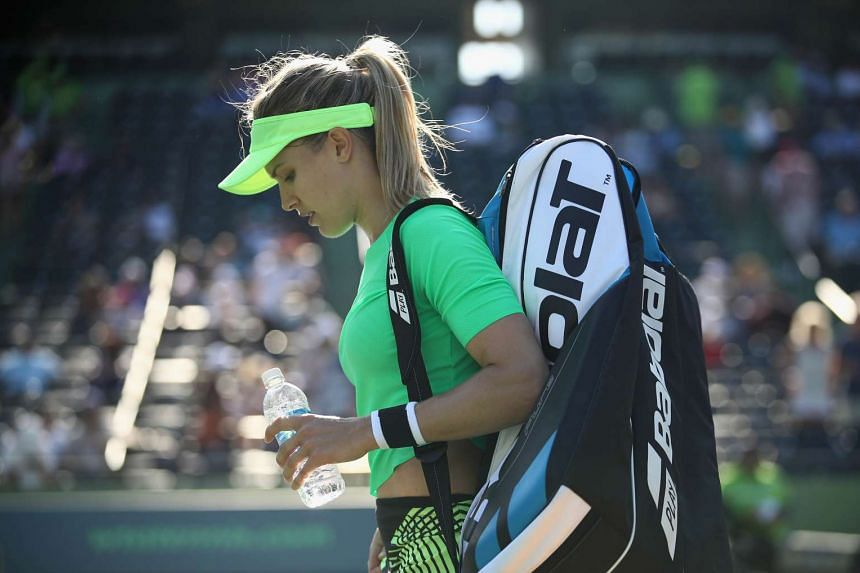 Eugenie Bouchard of Canada leaves the court after her loss against Ashleigh Barty.