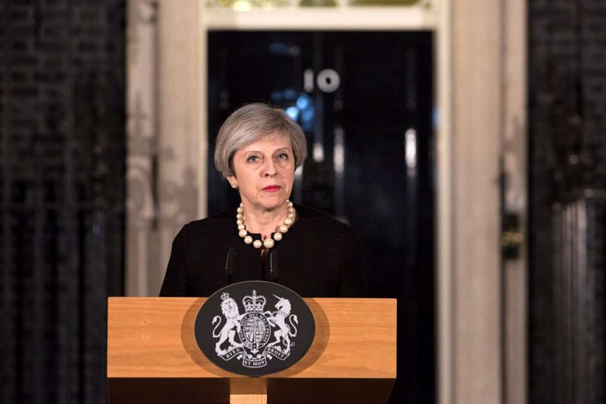 Britain's Prime Minister Theresa May makes a statement at Downing street in London following the attack in Westminster.
