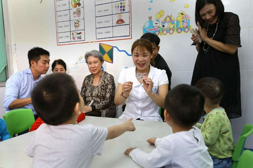Mrs Lee sits in at a special education class conducted by teachers at the National College of Education in Hanoi.