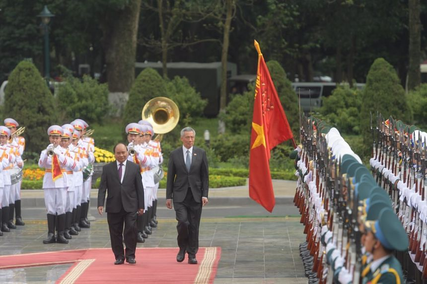 PM Lee with Vietnamese Prime Minister Nguyen Xuan Phuc during the welcome ceremony at the Presidential Palace in Hanoi, Vietnam, on March 23, 2017.