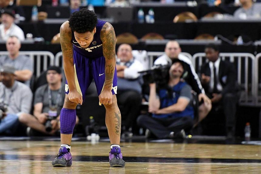 David Crisp of the Washington Huskies reacts after missing a three-pointer that would have tied the game with seconds left in a first-round game of the Pac-12 Basketball Tournament against the USC Trojans at T-Mobile Arena on March 8, 2017 in Las Veg