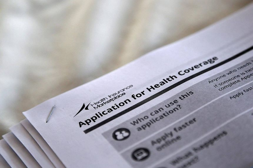 The federal government forms for applying for health coverage are seen at a rally held by supporters of the Affordable Care Act, outside the Jackson-Hinds Comprehensive Health Center in Jackson, Mississippi, US.