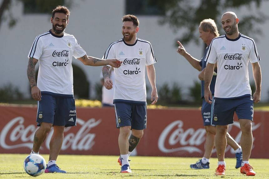 (From left) Ezequiel Lavezzi, Lionel Messi and Javier Mascherano looking relaxed during training in Buenos Aires. Argentina will face Chile today, sitting outside the automatic World Cup qualifying places.