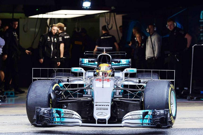 Three-time world champion Lewis Hamilton leaving the garage during testing near Barcelona. He and new team-mate Valtteri Bottas are said to be getting along well.