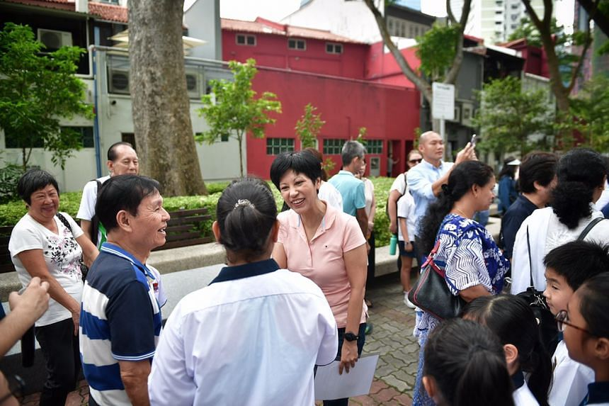 MPs for Tanjong Pagar GRC including Ms Indranee Rajah (in pink) joined grassroots leaders and around 100 residents to plant 13 different species of shrubs in two areas of the constituency.