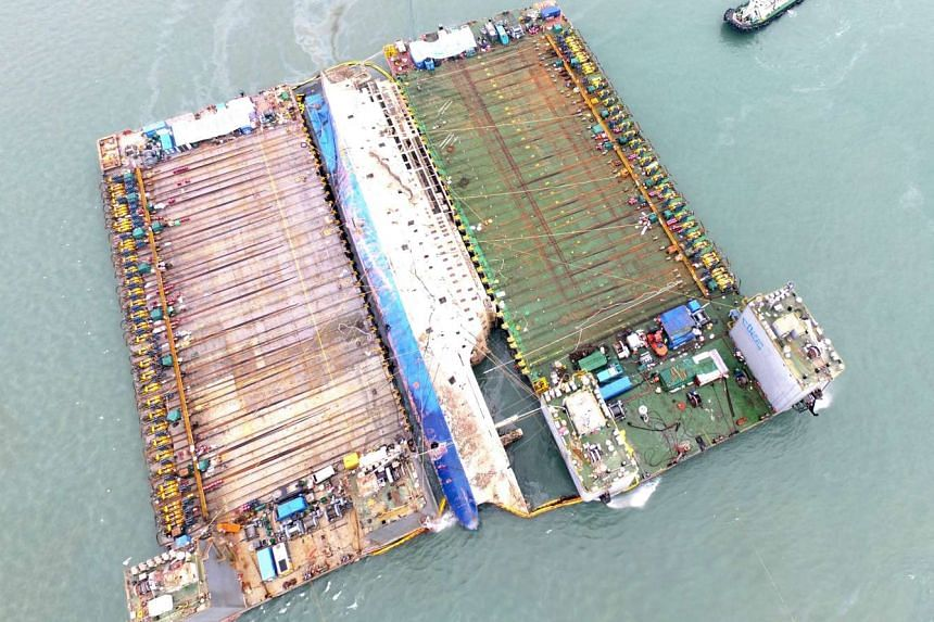 The sunken ferry Sewol prepares to move onto semisubmersible ship (not pictured) during its salvage operations at the sea off Jindo, South Korea, March 24, 2017.