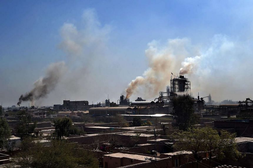 Smoke rises from factories on the outskirts of the north-western city of Peshawar in Pakistan.