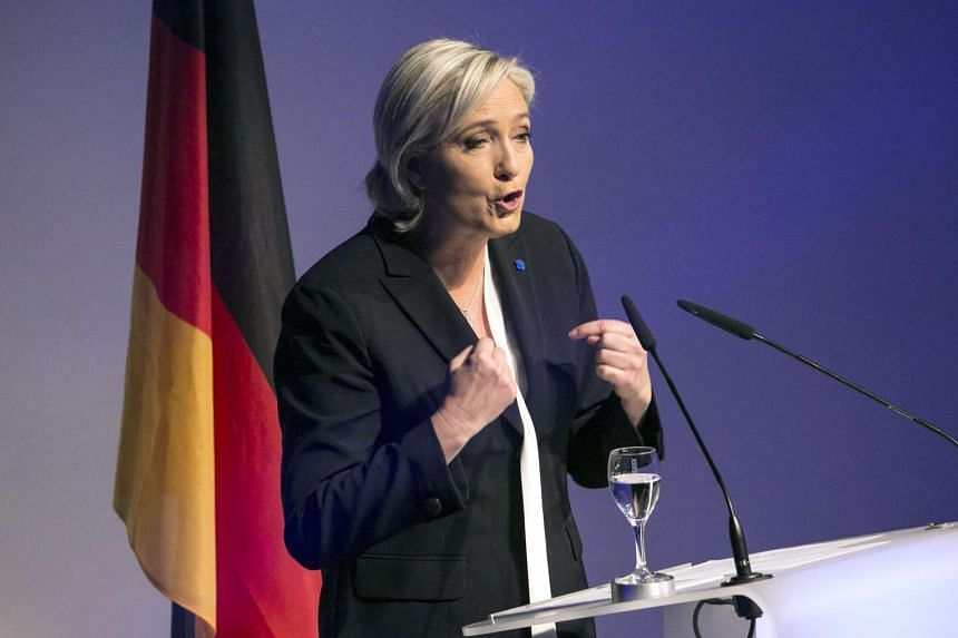Marine Le Pen gestures as she speaks during a Europe of Nations and Freedom meeting in Koblenz, Germany, on Saturday, Jan 21, 2017