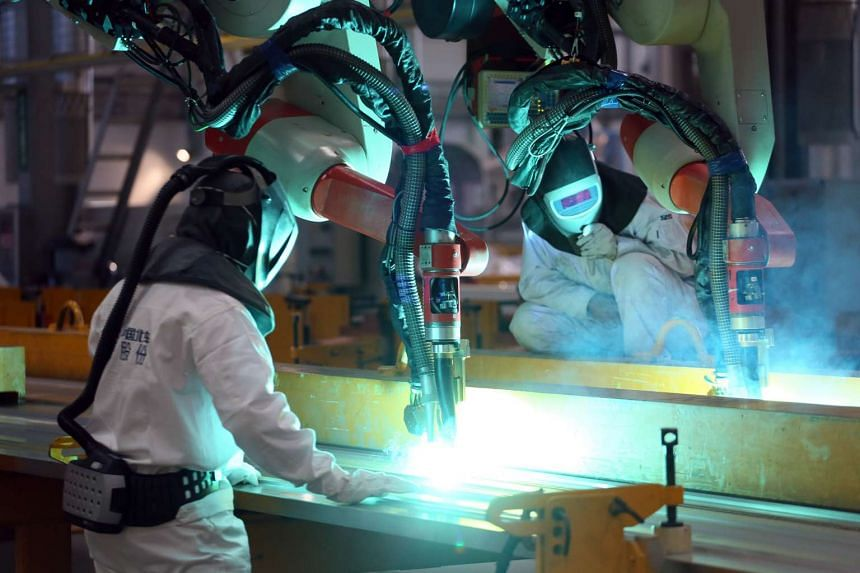 At Bombardier's manufacturing facility in Changchun, China, robotic arms are used to weld aluminium panels for the flooring and roof of the trains for the Downtown Line.