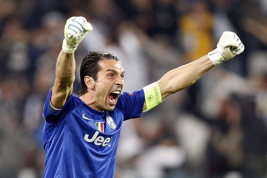 Juventus goalkeeper Gianluigi Buffon celebrates during the Champions League soccer match at Juventus stadium in Turin, October 2, 2013.